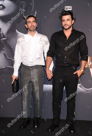 "Stock Photo of Designer Marc Jacobs, left, and boyfriend Harry Louis arrive at a ""Lady Gaga Fame"" fragrance launch event at the Guggenheim Museum on in New York. The black tie masquerade event will feature a performance art piece by Lady Gaga, Sleeping with Gaga. The film for ""Lady Gaga Fame"", directed by Steven Klein, will also be unveiled during the evening"
