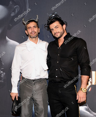 "Designer Marc Jacobs, left, and boyfriend Harry Louis arrive at a ""Lady Gaga Fame"" fragrance launch event at the Guggenheim Museum on in New York. The black tie masquerade event will feature a performance art piece by Lady Gaga, Sleeping with Gaga. The film for ""Lady Gaga Fame"", directed by Steven Klein, will also be unveiled during the evening"