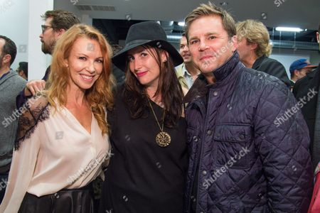 Stock Image of Challen Cates, left, Lauri Firstenberg and Aaron MacPherson attend the LAXART Opening at 7000 Santa Monica Blvd., in Los Angeles