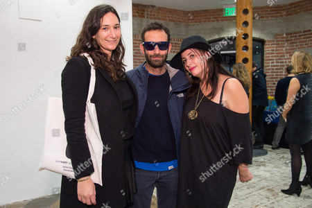 Bettina Korek, left Alex Israel and Lauri Firstenberg attend the LAXART Opening at 7000 Santa Monica Blvd., in Los Angeles