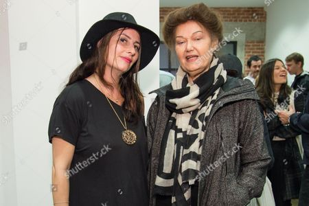 Lauri Firstenberg, left, and Mary Kelly attend the LAXART Opening at 7000 Santa Monica Blvd., in Los Angeles