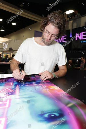 """Director Henry Joost signs autographs at Lionsgate """"Nerve"""" Talent Signing at 2016 Comic-Con, in San Diego, Calif"""