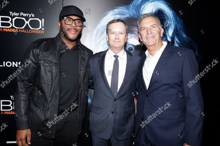 """Stock Photo of Director/Writer/Producer/Actor Tyler Perry, Michael Burns, Vice Chairman of Lionsgate, and Steve Beeks, Lionsgate's Co-Chief Operating Officer and President of the Motion Picture Group, seen at Lionsgate Presents the World Premiere of Tyler Perry's """"Boo! A Madea Halloween"""" at ArcLight Cinerama Dome, in Los Angeles"""
