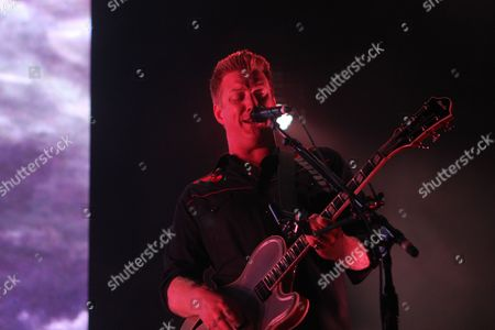 Joshua Homme of Queens of the Stone Age performing as part of Music Midtown 2013 at Piedmont Park, in Atlanta