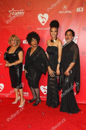 L-R) Singers Darlene Love, Merry Clayton, Judith Hill and Lisa Fischer arrive at the MusiCares 2014 Person of the Year Tribute on in Los Angeles