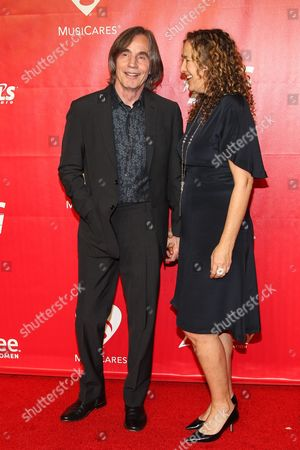 Singer Jackson Browne and Dianna Cohen arrive at the MusiCares 2014 Person of the Year Tribute on in Los Angeles