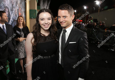 Katie Jackson and Elijah Wood seen at New Line Cinema and Metro-Goldwyn-Mayer Pictures presents the Los Angeles Premiere of 'The Hobbit: The Battle of The Five Armies', in Los Angeles