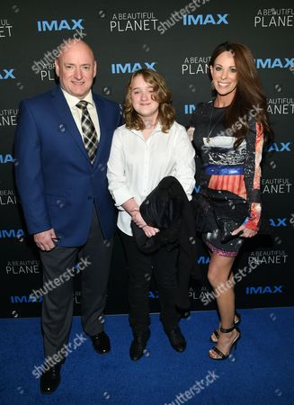 """Former NASA Astronaut Scott Kelly poses with his daughter Charlotte and girlfriend Amiko Kauderer at the premiere of """"A Beautiful Planet"""" at AMC Loews Lincoln Square, in New York"""