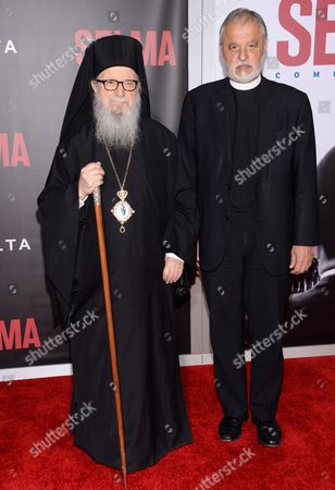 """Archbishop Demetrios of America, left, and Father Karloytsos attend the premiere of """"Selma"""" at the Ziegfeld Theatre, in New York"""