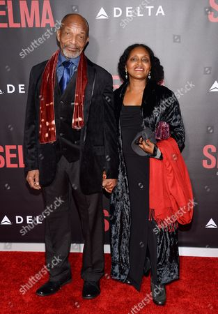 """Henry G. Sanders and guest attend the premiere of """"Selma"""" at the Ziegfeld Theatre, in New York"""