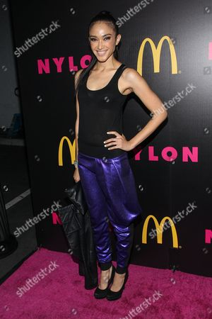 Stock Photo of Model Naima Mora arrives at the NYLON December/January Cover Launch Party Sponsored by McDonald's at Quixote Studios on in West Hollywood, CA