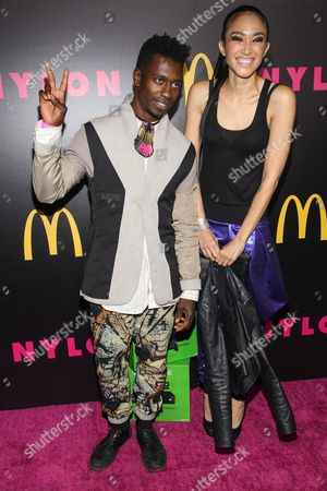 Stock Image of Model Naima Mora and Animals as Leaders guitarist Tosin Abasi (L) arrive at the NYLON December/January Cover Launch Party Sponsored by McDonald's at Quixote Studios on in West Hollywood, CA