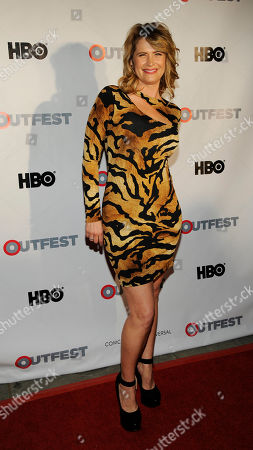 Actress Kristy Swanson poses at the Outfest 2014 Fusion LGBT People of Color Film Festival, in Los Angeles