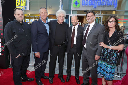 """Jean McDowell, SVP of Marketing and Research, Lionsgate, Steve Beeks, Co-Chief Operating Officer and Co-President, Lionsgate Motion Picture Group, Executive Producer Avi Lerner, Jason Statham, Jason Constantine, President of Acquisitions and Co-Productions, Lionsgate Motion Picture Group, and Eda Kowan, EVP, Acquisitions & Co-Productions, Lionsgate, seen at Los Angeles Premiere of """"Mechanic: Resurrection"""" from Lionsgate's Summit Premiere Label at ArcLight Hollywood, in Los Angeles"""