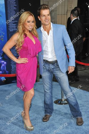"""Sabrina Bryan, left and Louis Van Amstel attend the premiere of """"Finding Nemo"""" 3D at the El Capitan Theatre, in Los Angeles"""