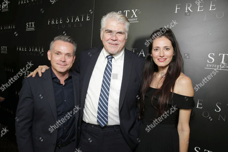 "Stock Picture of Executive Producer T.G. Herrington, Writer/Director/Producer Gary Ross and Associate Producer Diana Alvarez seen at Los Angeles Premiere of STX Entertainment ""Free State of Jones"" at DGA Theater, in Los Angeles"