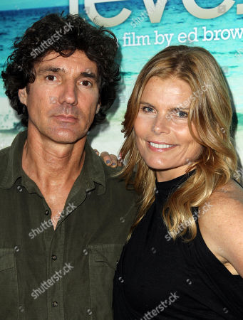 """Mariel Hemingway, right, and Bobby Williams arrive at the premiere of the documentary film """"Unacceptable Levels"""" at ArcLight Cinemas in Los Angeles"""