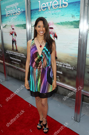 """Stock Image of Chuti Tiu arrives at the premiere of the documentary film """"Unacceptable Levels"""" at ArcLight Cinemas in Los Angeles"""