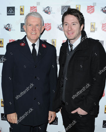 Major George Hood, at left, and Adam Young are seen at Rock The Red Kettle to benefit The Salvation Army, part of AEG's Season Of Giving at L.A. LIVE,, at LA Live in Los Angeles
