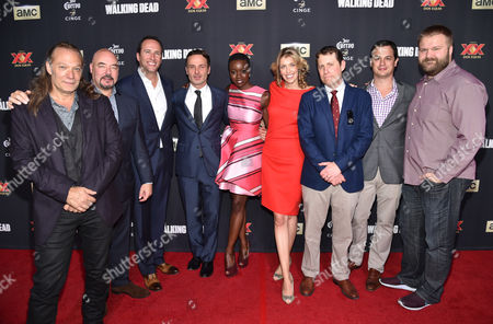 """Director/executive producer Greg Nicotero, and from left, Joel Stillerman, Charlie Collier, president/general manager of AMC, Andrew Lincoln, Danai Gurira, and executive producers Denise M. Huth, Scott M. Gimple, Dave Alpert and Robert Kirkman attend the season five premiere of """"The Walking Dead"""" at AMC Universal Citywalk, in Universal City, Calif"""