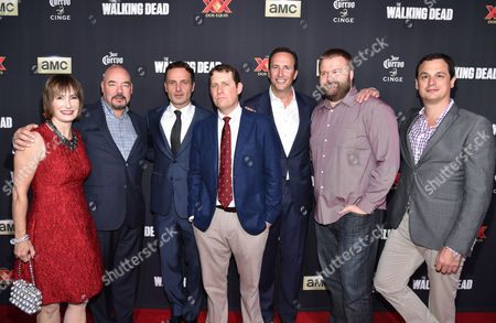 """Executive producer Gale Anne Hurd, and from left, Joel Stillerman, Andrew Lincoln, executive producer Scott M. Gimple and Charlie Collier, president/general manager of AMC, and executive producers Robert Kirkman and Dave Alpert attend the season five premiere of """"The Walking Dead"""" at AMC Universal Citywalk, in Universal City, Calif"""