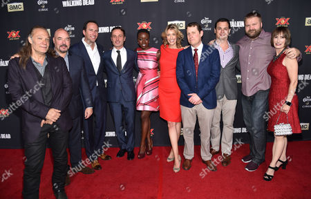 """Director/executive producer Greg Nicotero, and from left, Joel Stillerman, Charlie Collier, president/general manager of AMC, Andrew Lincoln, Danai Gurira, and executive producers Denise M. Huth, Scott M. Gimple, Dave Alpert, Robert Kirkman and Gale Anne Hurd attend the season five premiere of """"The Walking Dead"""" at AMC Universal Citywalk, in Universal City, Calif"""