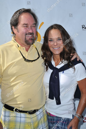 Richard Karn, at left, and Liz Rusnak arrive at the Seventh Annual George Lopez Celebrity Golf Classic at Lakeside Golf Club, in Toluca Lake, Calif