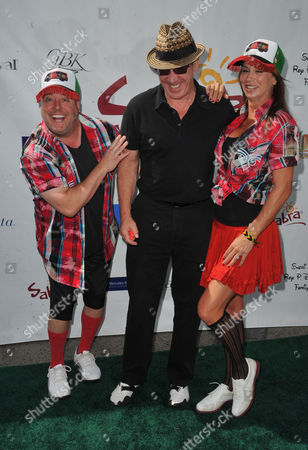 Gary Valentine, from left, Tim Allen, and Debbe Dunning arrives at the Seventh Annual George Lopez Celebrity Golf Classic at Lakeside Golf Club, in Toluca Lake, Calif