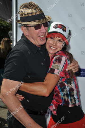 Tim Allen, at left, and Debbe Dunning arrive at the Seventh Annual George Lopez Celebrity Golf Classic at Lakeside Golf Club, in Toluca Lake, Calif
