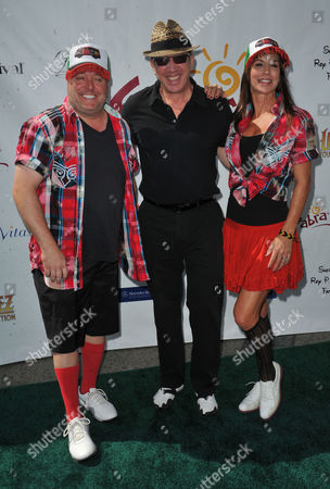 Gary Valentine, from left, Tim Allen, and Debbe Dunning arrive at the Seventh Annual George Lopez Celebrity Golf Classic at Lakeside Golf Club, in Toluca Lake, Calif