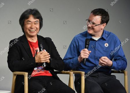 Japanese video game designer and producer Shigeru Miyamoto, left, and senior product marketing manager of Nintendo of America and interpreter, Bill Trinen, make an appearance at the Apple SoHo store to promote Super Mario Run for iOS, in New York