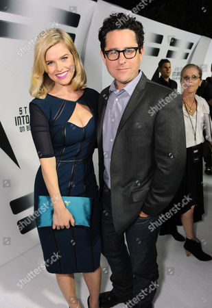 Alice Eve, left, and Director J.J. Abrams arrive on the white carpet to celebrate the home entertainment debut of the worldwide blockbuster Star Trek Into Darkness on at the California Science Center in Los Angeles