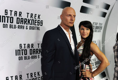 "Joseph Gatt, left, from the worldwide blockbuster ""Star Trek Into Darkness"" gathers with guest to celebrate the film's home entertainment debut on Tuesday, Sept, 10, 2013 at the California Science Center in Los Angeles"