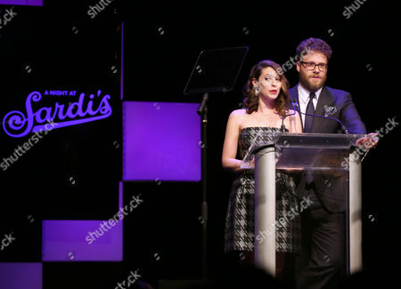 """Lauren Miller and Seth Rogen speak at the 24th annual Alzheimer's Association """"A Night at Sardi's"""" at the Beverly Hilton hotel, in Beverly Hills, Calif"""