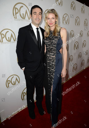 Jonathan Gordon and Catherine McCord arrive at the 25th annual Producers Guild of America (PGA) Awards at the Beverly Hilton Hotel, in Beverly Hills, Calif