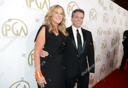 Lori McCreary and Michael De Luca arrives at the 25th annual Producers Guild of America (PGA) Awards at the Beverly Hilton Hotel, in Beverly Hills, Calif
