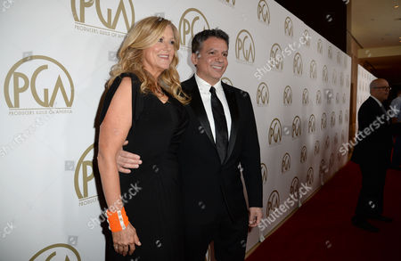 Lori McCreary and Michael De Luca arrive at the 25th annual Producers Guild of America (PGA) Awards at the Beverly Hilton Hotel, in Beverly Hills, Calif