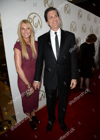 Krista Levitan and Steven Levitan arrive at the 25th annual Producers Guild of America (PGA) Awards at the Beverly Hilton Hotel, in Beverly Hills, Calif