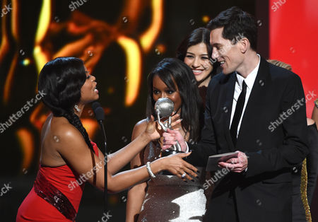 Taraji P. Henson, left, presents the award for outstanding drama series to Peter Nowalk and the cast and crew of How to Get Away with Murder on stage at the 46th NAACP Image Awards at the Pasadena Civic Auditorium, in Pasadena, Calif