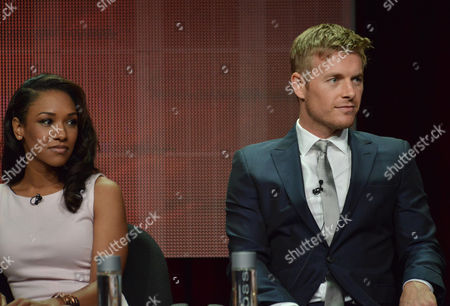 """Candice Patton and Rick Cosnett speak on stage during the """"The Flash"""" panel at the The CW 2014 Summer TCA held at the Beverly Hilton Hotel, in Beverly Hills, Calif"""