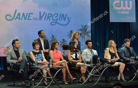 "Executive Producers Ben Silverman, back row from left, and Jennie Syder Urman, and from front row left, Jamie Camil, Ivonne Coll, Andrea Navedo, Gina Rodriguez, Justin Baldoni, Yael Grobglas and Brett Dier appear on stage during the ""Jane The Virgin"" panel at the The CW 2014 Summer TCA held at the Beverly Hilton Hotel, in Beverly Hills, Calif"
