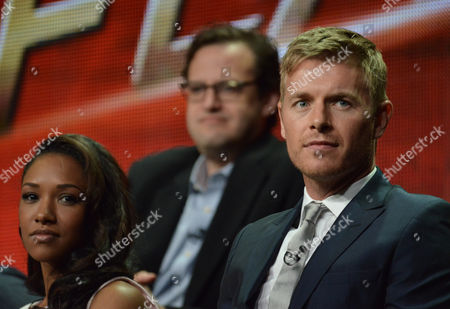 """From left, Candice Patton, Executive Producer Andrew Kreisberg and Rick Cosnett speak on stage during """"The Flash"""" panel at the The CW 2014 Summer TCA held at the Beverly Hilton Hotel, in Beverly Hills, Calif"""
