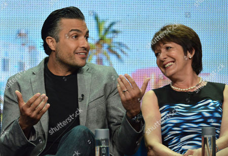 "Jamie Camil, left, and Ivonne Coll speak on stage during the ""Jane The Virgin"" panel at the The CW 2014 Summer TCA held at the Beverly Hilton Hotel, in Beverly Hills, Calif"