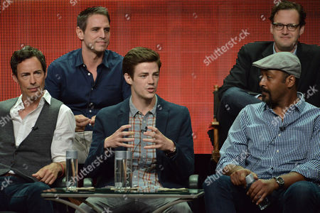 """Top Row, Executive Producer Greg Berlanti, Executive Producer Andrew Kreisberg,Bottom Row, Tom Cavanagh, Grant Gustin and Jesse L. Martin speak on stage during the """"The Flash"""" panel at the The CW 2014 Summer TCA held at the Beverly Hilton Hotel, in Beverly Hills, Calif"""