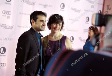 Stock Picture of Attorney and activist Sandra Fluke, right, and Adam Mutterperl arrive at The Hollywood Reporter's 21st Annual Women in Entertainment Power 100 breakfast presented by Lifetime on in Beverly Hills, Calif