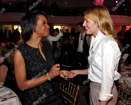 The Style Network Presiden Salaam Coleman Smith, left, and actress Cat Deeley greet each other at The Hollywood Reporter's 21st Annual Women in Entertainment Power 100 breakfast presented by Lifetime on in Beverly Hills, Calif
