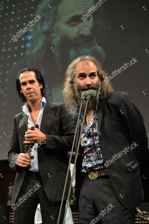Nick Cave and Warren Ellis receive the Album of the Year Award at the 59th Ivor Novello Awards at the Grosvenor House in London on