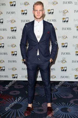 Ed Drewett arriving for the 59th Ivor Novello Awards, at the Grosvenor House Hotel, London, on . Photo by Mark Allan /Invision/AP