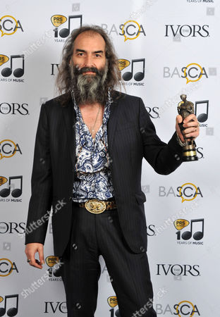 Warren Ellis with his Album of the Year Award at the 59th Ivor Novello Awards at the Grosvenor House in London on