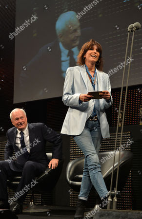 Chrisie Hynde presents Warren Ellis and Nick Cave the Album of the Year Award at the 59th Ivor Novello Awards at the Grosvenor House in London on